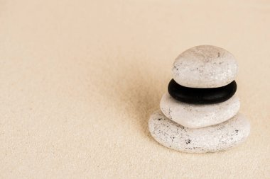 Close up view of zen stones on sand surface stock vector