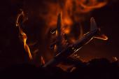 Crash of toy plane with smoke on black background, battle scene