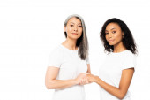 attractive african american and asian women holding hands isolated on white