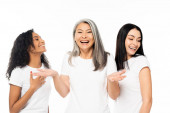 emotional multicultural women smiling isolated on white