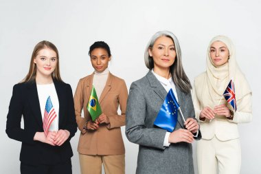 Multicultural businesswomen with flags of different countries isolated on white stock vector