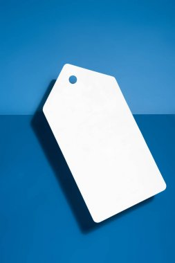 White big blank price tag on blue background stock vector