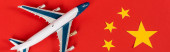 Photo panoramic shot of toy airplane on red chinese flag