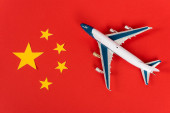 Photo top view of toy airplane on red chinese flag
