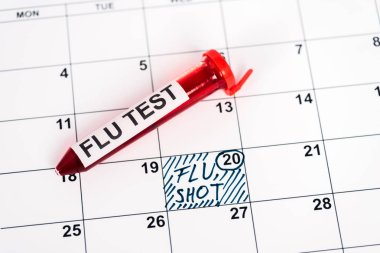 Sample with flu test on calendar with marked date and flu shot lettering stock vector