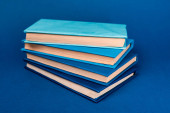 bright books with copy space on blue background