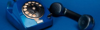 Panoramic shot of retro telephone on blue background stock vector