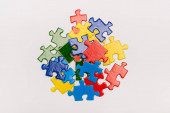 Top view of bright multicolored pieces of puzzle isolated on white, autism concept