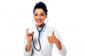 Fotografie African american doctor with thumb up showing stethoscope and smiling isolated on white