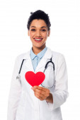 Front view of african american doctor with stethoscope showing decorative red heart isolated on white