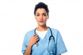 Front view of african american nurse with stethoscope looking at camera isolated on white