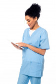 African american nurse using digital tablet isolated on white