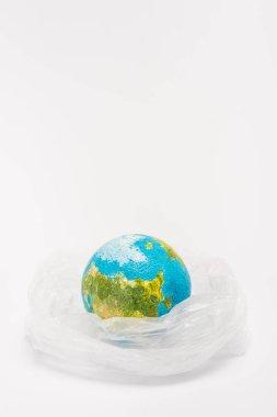 Globe inside plastic bag on white background, global warming concept stock vector