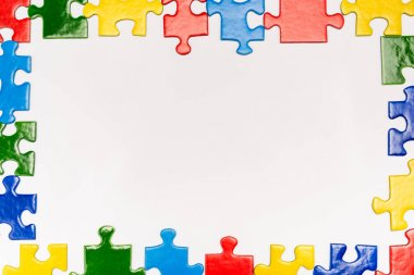 Top view of frame with bright pieces of puzzle on white, autism concept stock vector