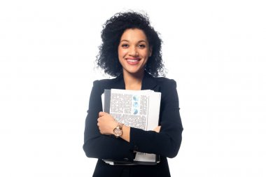 Front view of positive african american businesswoman with documents looking at camera isolated on white stock vector