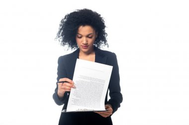 Front view of concentrated african american businesswoman reading contract isolated on white stock vector