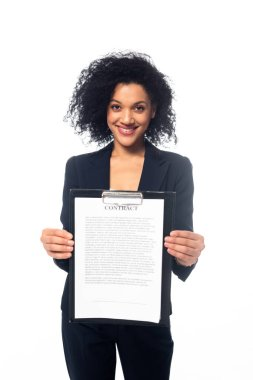 Front view of happy african american businesswoman smiling and showing contract isolated on white stock vector