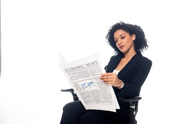 Concentrated african american businesswoman in office chair reading newspaper isolated on white stock vector
