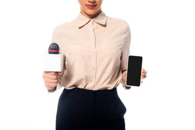 Partial view of african american journalist with microphone showing smartphone isolated on white