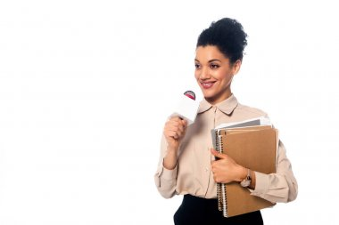 African american journalist with microphone, documents and notebooks smiling isolated on white