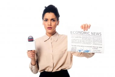 Front view of worried african american journalist showing newspaper with economic news lettering isolated on white