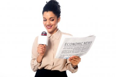 Front view of african american journalist holding newspaper with economic news lettering isolated on white