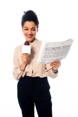 Front view of african american journalist holding newspaper with economic news inscription isolated on white