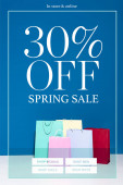 Photo colorful paper shopping bags on blue background, 30 percent off spring sale illustration