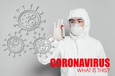 Asian epidemiologist in hazmat suit and respirator mask showing test tube with blood sample on grey background, coronavirus illustration stock vector