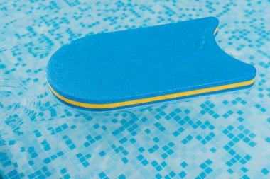 flutter board in swimming pool with blue water