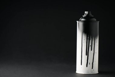 graffiti paint can on black with copy space