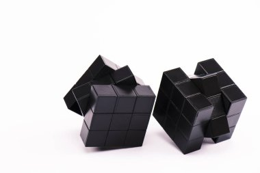 KYIV, UKRAINE - FEBRUARY 21, 2020: black rubik cubes for strategy game on white with copy space stock vector