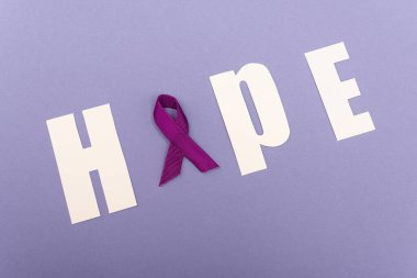 High angle with of word hope with purple ribbon isolated on purple stock vector