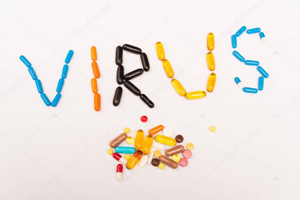 Top view of virus lettering and pile of pills on white background stock vector
