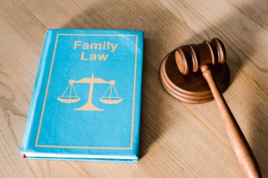 gavel near book with family law lettering on wooden desk
