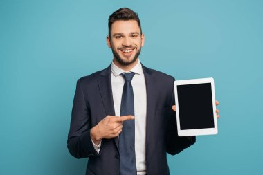 Happy businessman pointing with finger at smartphone with blank screen on blue background stock vector