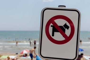 Selective focus of no dogs prohibition sign on beach in Catalonia, Spain