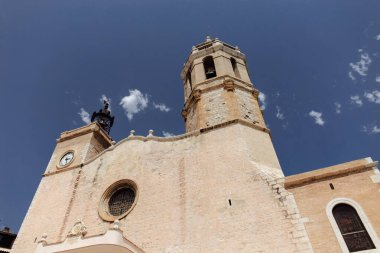 Low angle view of church of San Bartolome and Santa Tecla with blue sky at background in Barcelona, Spain stock vector