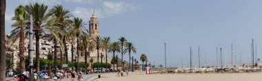 BARCELONA, SPAIN - APRIL 30, 2020: People on urban street with palm trees and Church of Saint Bartolomeus and Santa Tecla at background, panoramic crop stock vector