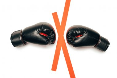 Pair of black boxing gloves ready to fight isolated on white stock vector