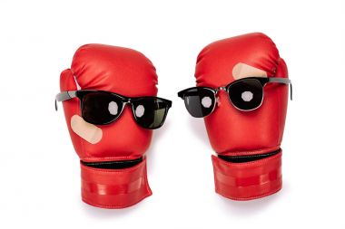 Pair of red boxing gloves in sunglasses making smiley composition isolated on white stock vector