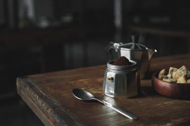 espresso maker with coffee on wooden tabletop