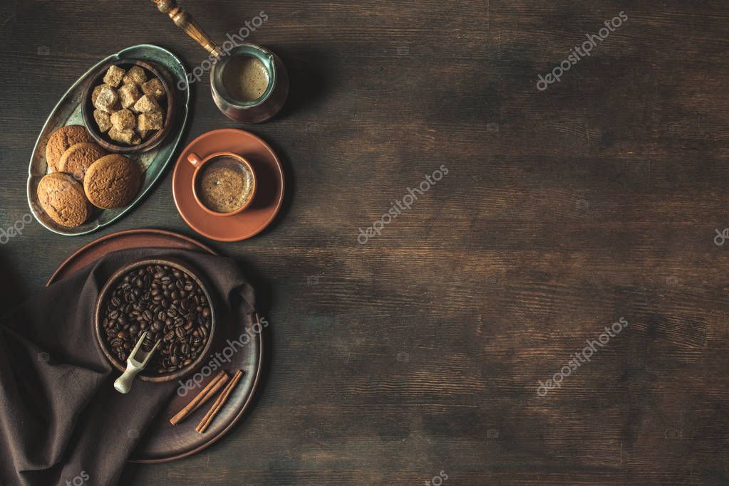 coffee with beans and brown sugar with cookies