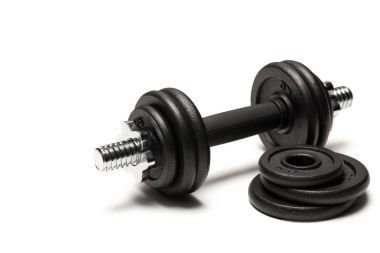 Close up of iron dumbbell with weight plates isolated on white stock vector