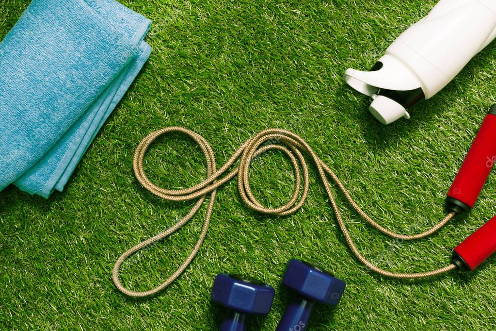 jump rope with towel and bottle on grass