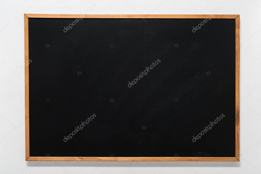 empty school blackboard in wooden frame