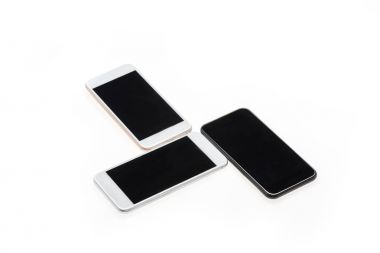Three modern smartphones with black screens isolated on white stock vector