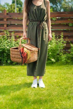 Woman holding picnic basket