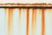 Photo Rusty pipe on wall