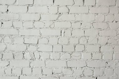 Close-up view of white grungy brick wall textured background stock vector